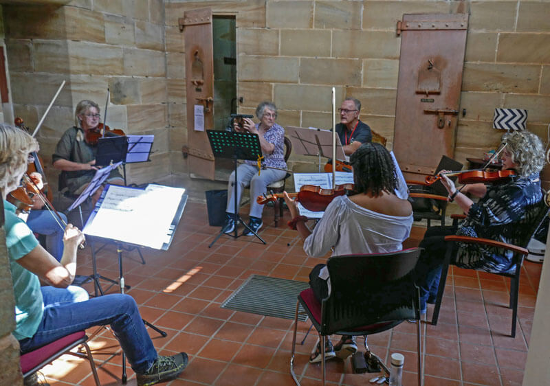 Violin twos practicing in Gaol
